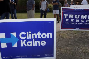 Campaign signs are shown in Dallas. (AP Photo/Tony Gutierrez