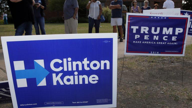 Campaign signs are shown in Dallas. (AP Photo/Tony Gutierrez