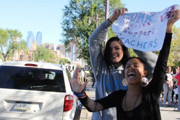 Students get support from passing motorists on South Broad Street during an Oct. 8