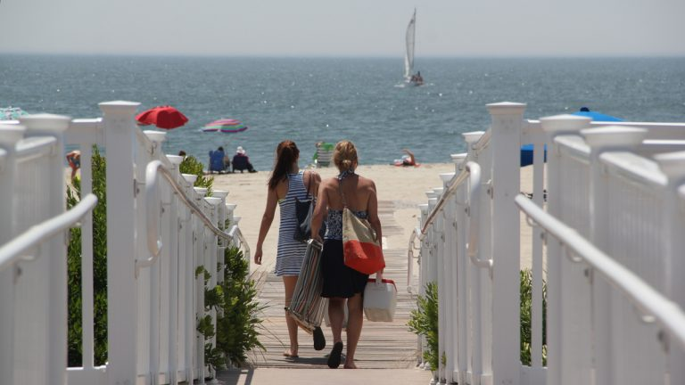 Vacationers take to the beach at Cape May. (Emma Lee/WHYY)