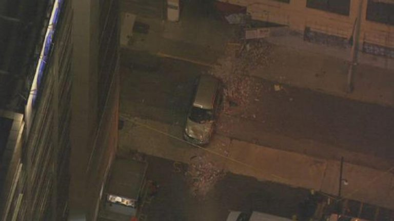 SkyForce10 captures the scene of a car accident that collapsed a building wall (NBC10 Image)