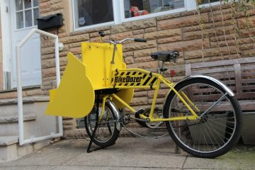 The Falkowski family of South Philly does not own a car and uses public transit and the 'Bike Dozer', which can seat one adult and two small children, to get around. (Kimberly Paynter/WHYY)