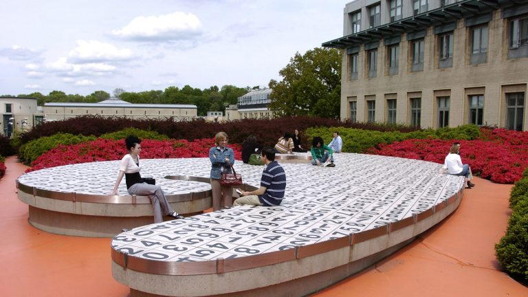 Students socialize on campus between classes at Carnegie Mellon University in Pittsburgh, Pa. (AP Photo/Carnegie Mellon University, Ken Andreyo)