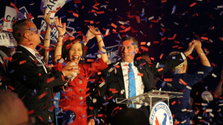 Governor-elect John Carney (blue tie) celebrates with the woman who will replace him in Congress