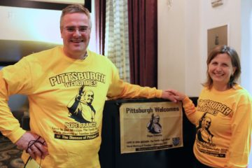 John Cascino and Becky Cascino show their Pittsburgh pride at a welcoming reception for pilgrims in Philadelphia. (Marielle Segarra/WHYY)