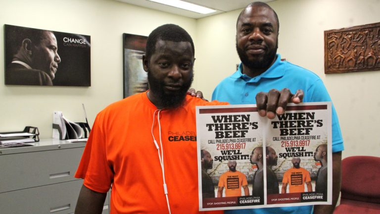 CeaseFire supervisor Quinzel Tomoney (left) and project manager Robert Warner are fighting gun violence in North Philadelphia. (Emma Lee/WHYY)
