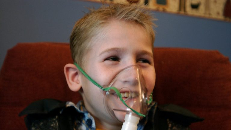 A cystic fibrosis patient receives one of his twice daily treatments for cystic fibrosis (AP Images