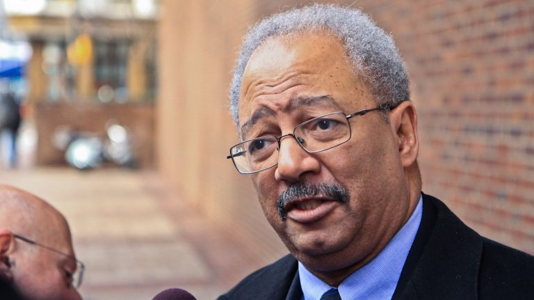 Congressman Chaka Fattah answers questions outside the Federal Courthouse Tuesday. (Kimberly Paynter/WHYY)