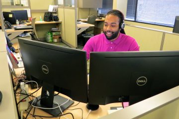 ITWorks graduate Aundre Chambers had to drop out of college because he couldn't afford the tuition. He now works as an IT service desk analyst at WSFS Bank in Wilmington. (Rob Zawatski/WHYY)