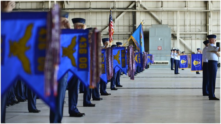 Squadron commanders present arms during a change of command ceremony Aug. 15, 2014, at Dover Air Force Base, Del. (U.S. Air Force photo/Airman 1st Class William Johnson)