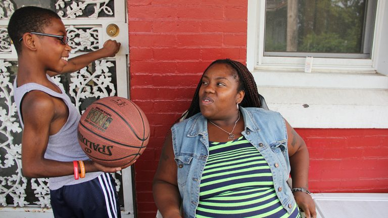 Rosalinda Harris worries that her son's medical needs aren't being met at Blaine Elementary. Her son,Chance Nelson,11, was born with a heart defect. (Emma Lee/WHYY)