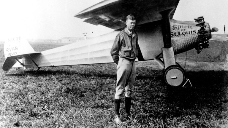 Charles A. Lindbergh is shown in this 1927 file photo with his plane, the Spirit of St. Louis, with which he made the first solo crossing of the Atlantic Ocean from west to east, the same year. (AP Photo, file)