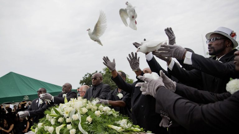 Pallbearers are shown releasing doves over the casket of Ethel Lance during her burial service on June 25, 2015, in Charleston, S.C. It was the first funeral for the nine people killed in the shooting at Emanuel AME Church, (AP Photo/David Goldman)