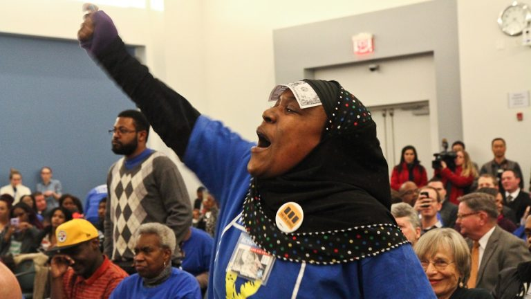 Tyesha Anderson protests charter expansion at Wednesday's charter hearings. (Kimberly Paynter/WHYY)