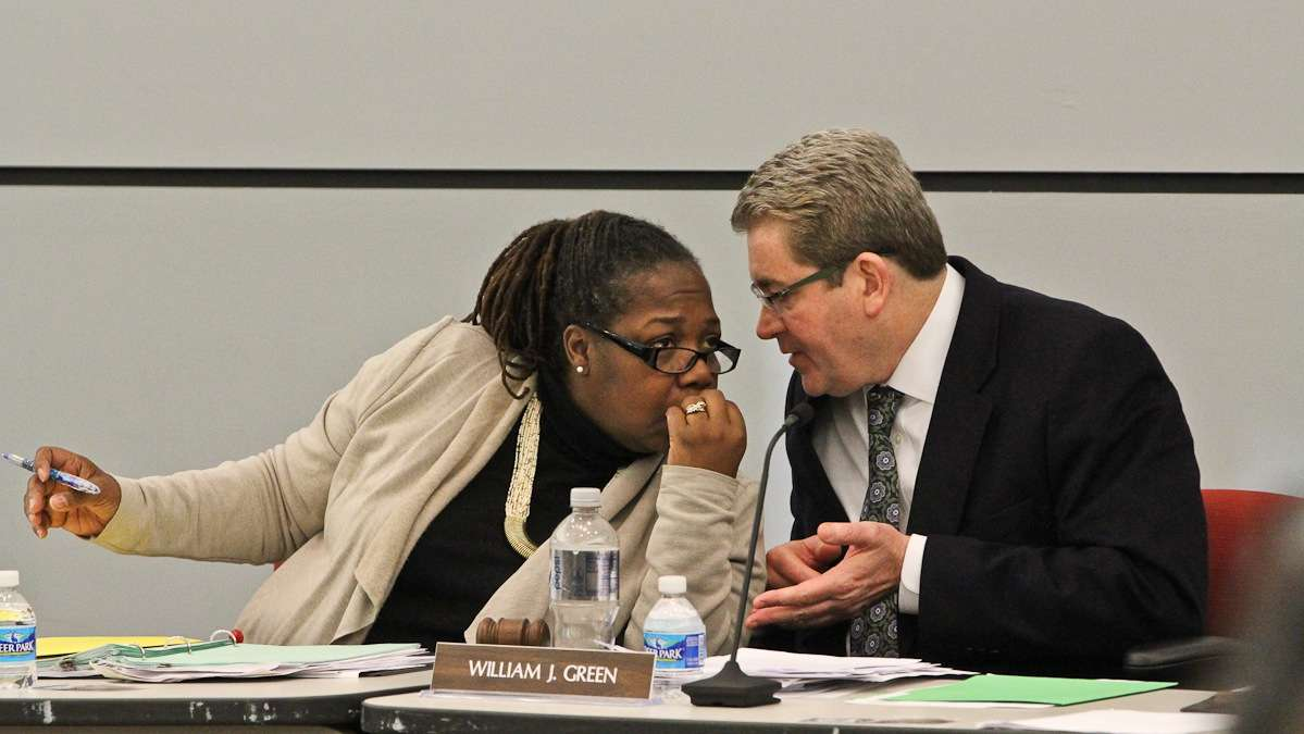 School Reform Commission members Sylvia Simms and Bill Green confer during hearings on charters school applications. Gov. Tom Wolf has said he's liked to dissolve the SRC, but not immediately.(NewsWorks file photo)