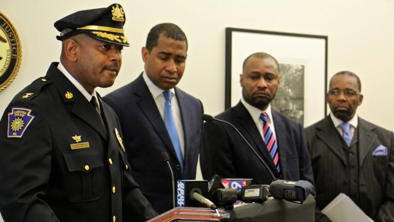 Chester Police Commissioner Darren Alston (left) says he will subject his force to a U.S. Deparment of Justice review examining officer-involved shootings and community policing practices. With him are (from left) U.S. Attorney Zane Memeger