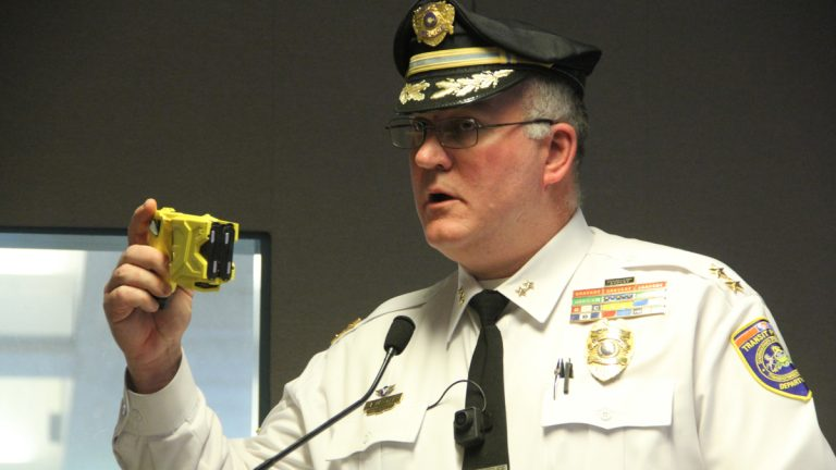 Chief of SEPTA Police Thomas Nestel holds a Taser like the one used on a combative suspect who later died in custody. (Emma Lee/WHYY)