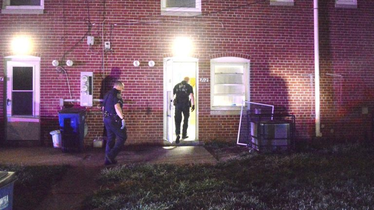 Police search for clues after a 10-year-old was shot early Tuesday morning. (John Jankowski/for NewsWorks)