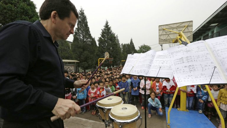 Christopher Deviney of the Philadelphia Orchestra performs as part of a outreach program to students at the Tongxin Experimental Primary School on the outskirts of Beijing