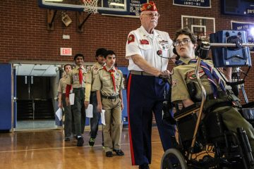 Christian Matcovish (right) became an Eagle Scout despite numerous hurdles. (WHYY)