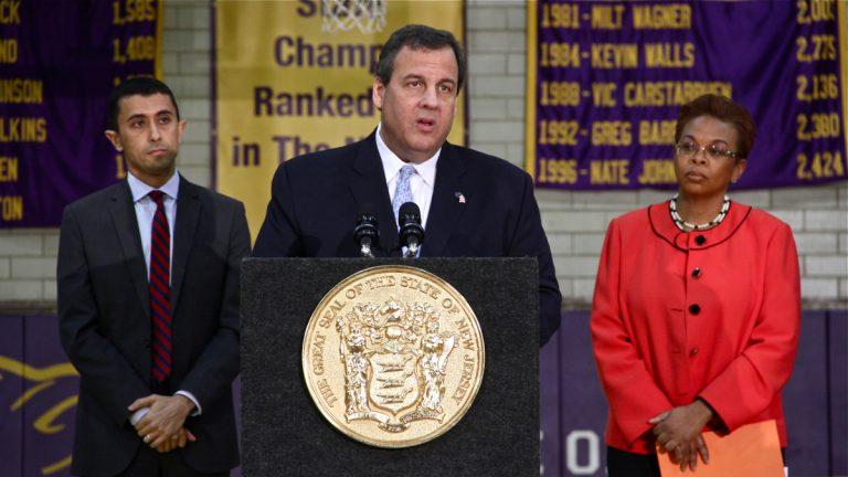 Gov. Chris Christie, flanked by Camden Schools Superintendent Paymon Rouhanifard and Mayor Dana Redd, announces a $50 million plan to rehabilitate Camden High School. (Emma Lee/WHYY)