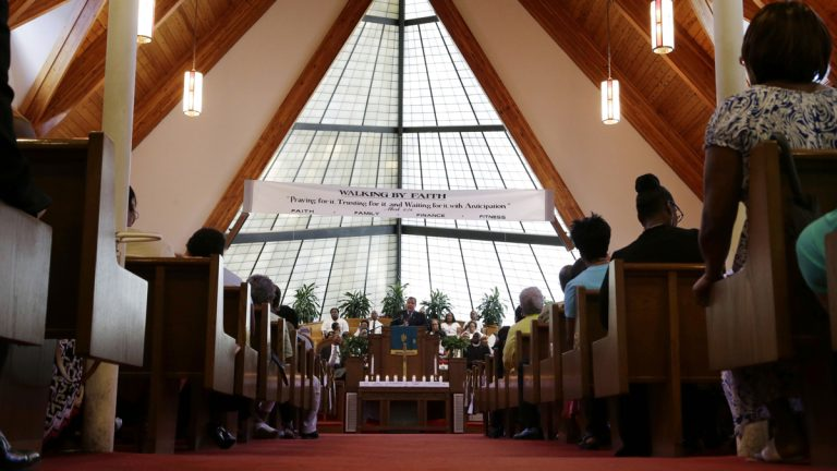 New Jersey Gov. Chris Christie, center at podium, addresses a gathering for a service at St. Matthew African Methodist Episcopal Church Sunday, June 21, 2015, in Orange, N.J. The service offered prayers and thoughts of the nine people who were killed at Emmanuel AME Church in Charleston, SC, last Wednesday. (AP Photo/Mel Evans)
