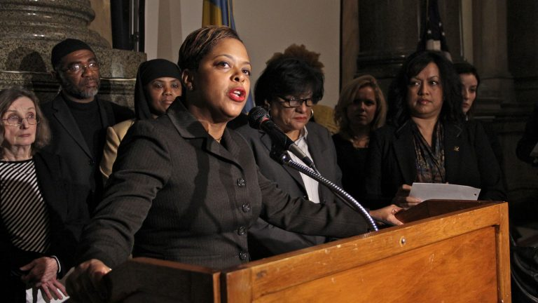 Cindy Bass joins other female City Council members and representatives of the Philadelphia Chapter of the National Organization for Women to call for the firing of three city prosecutors who traded pornographic emails while working for the state Attorney General. (Emma Lee/WHYY)