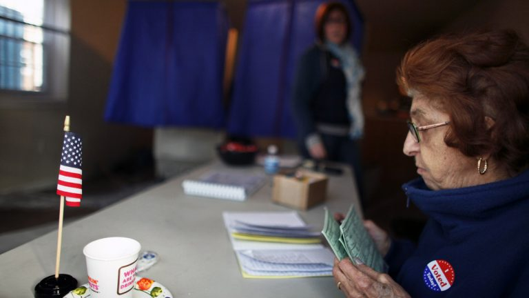 Voters sign in before casting their ballots at the Benjamin Franklin Elementary School in Northeast Philadelphia. (AP file photo)