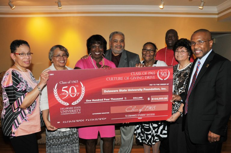 Members of the class of 1965 present their record gift at a May 18 reception. (Photo courtesy of Delaware State University)