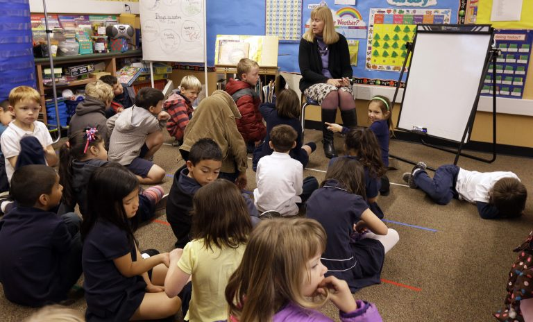 First grade teacher Lynda Jensen teaches her class of 30 children Thursday, Jan. 24, 2013, at the Willow Glenn Elementary School in San Jose, Calif. Classes in California's public schools are getting bigger. To save money on teacher salaries, school districts across the state have gotten into the habit of putting more children in classrooms and then seeking retroactive approval from the California State Board of Education.  Although bigger classes are unpopular with teachers and parents, research on the link between class size and learning has been inconclusive. (AP Photo/Ben Margot)