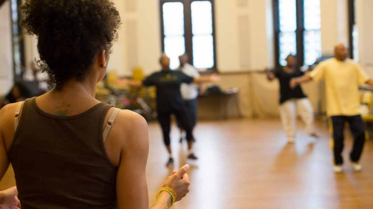 Older black volunteers do African dance together three times a week as part of a study. (Holli Stephens/for WHYY)