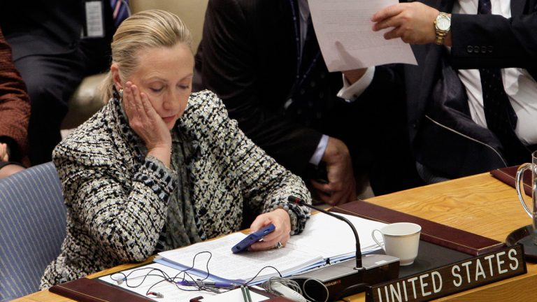 Then-Secretary of State Hillary Rodham Clinton is shown checking her mobile phone after her address to the Security Council at United Nations headquarters on March 12