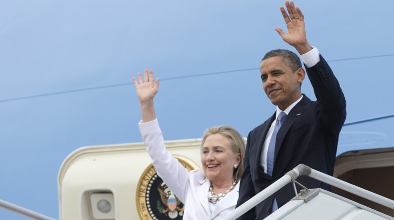 Barack Obama and Hillary Rodham Clinton (then secretary of state) are shown arriving in Myanmar on Air Force One in late 2012. (AP Photo/Carolyn Kaster)