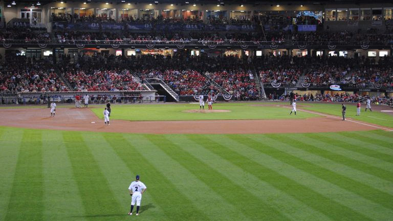 "The Lehigh Valley Iron Pigs play the Pawtucket Red Sox at Coca-Cola Park in Allentown, Pa. Greg Heller-LaBelle says ""silver bullet"" strategies like putting up stadiums don't spur economic development alone. (<a href="