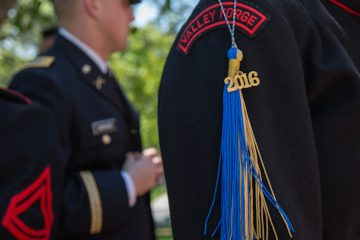 Cadets from the Valley Forge Military College hang their commencement tassels off of their uniforms for their graduation May 20th, 2016. (Emily Cohen for NewsWorks)