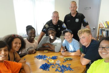 Collingswood students are shown working with police officers on a community relations project in 2015. (Matt Skoufalos/NJ Pen)