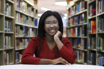 Octavia Coaks poses for a portrait at the Olive-Harvey College library in Chicago in 2015. The idea of free community college has been touted by Democrats and Republicans. Chicago offers the Star Scholarship. The idea is to curb student debt and boost employment by removing cost from the equation. But offering free community college isn't supported by everyone.  (AP file Photo/Charles Rex Arbogast)