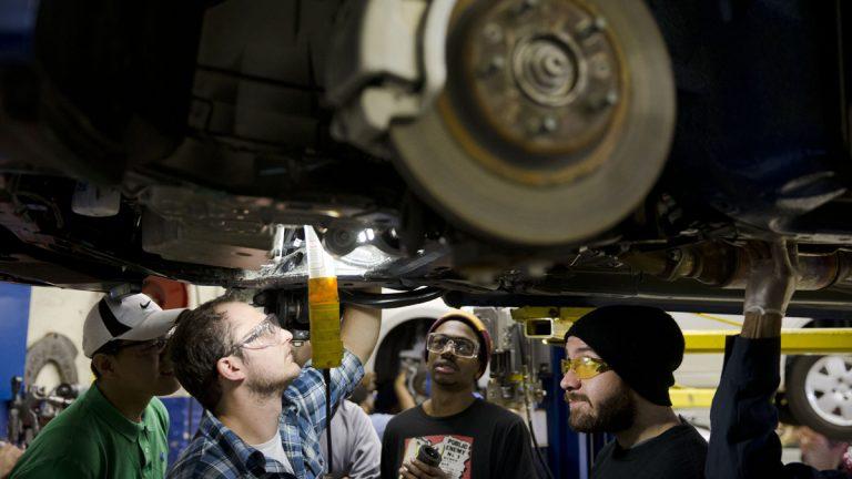 Automotive service technology students work on a car at the Community College of Philadelphia, in Philadelphia, Pa. (AP File Photo/Matt Rourke)