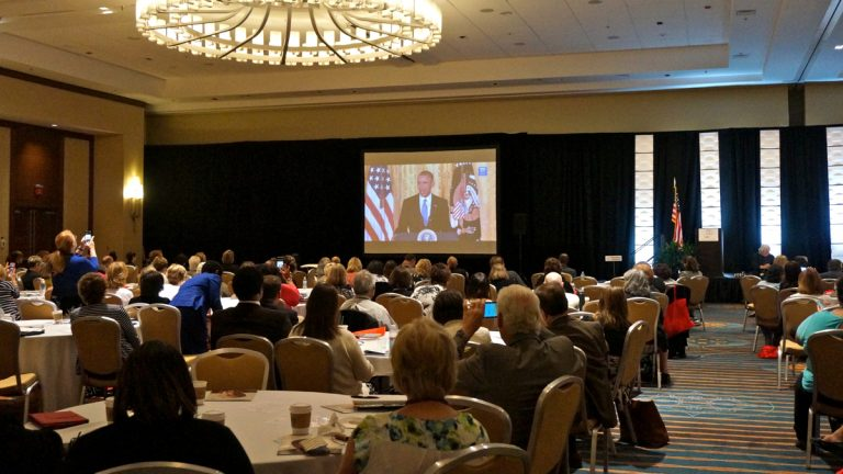 Those attending the annual meeting of the National Association of Area Agencies on Aging watched President Obama give a speech as part of Monday's White House Conference on Aging. (Jessica McDonald/WHYY)