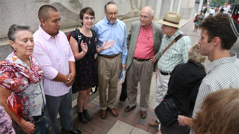 Members of Mishkan Shalom Synagogue and other congregations pray with Pedro Avila before his deportation hearing. (Photo credit: Harvey Finkle)