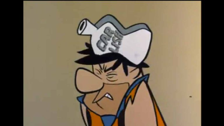 In season 1 episode 5 of The Flintstones, Fred gets conked on the head (as pictured here) and it completely changes his personality. A second conk later on reverses it. (Screen grab of The Flintstones)