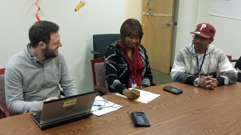 Recovery coaches Ben Goldstein and LaVonna Reed work with program participant John Hamm. (Erme Maula/Mental Health Association of SE Pennsylvania)