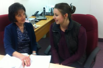 Rosemarie Scolaro Moser reviews cognitive testing with former concussion patient Andrea Cooper (Maiken Scott/for The Pulse)