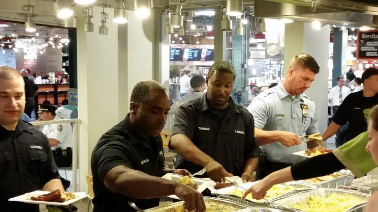 First responders who worked Amtrak crash enjoy breakfast at Reading Terminal Market (Tom MacDonald/WHYY)