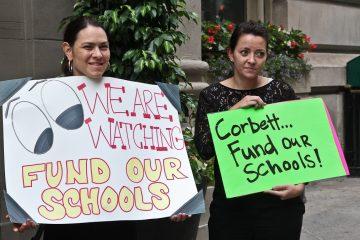 Parent Gretchen Elise Walker and former Philadelphia public school grad Erica Gendall-Conrad protest outside of Governor Corbett's office in Philadelphia. (Kimberly Paynter/WHYY)