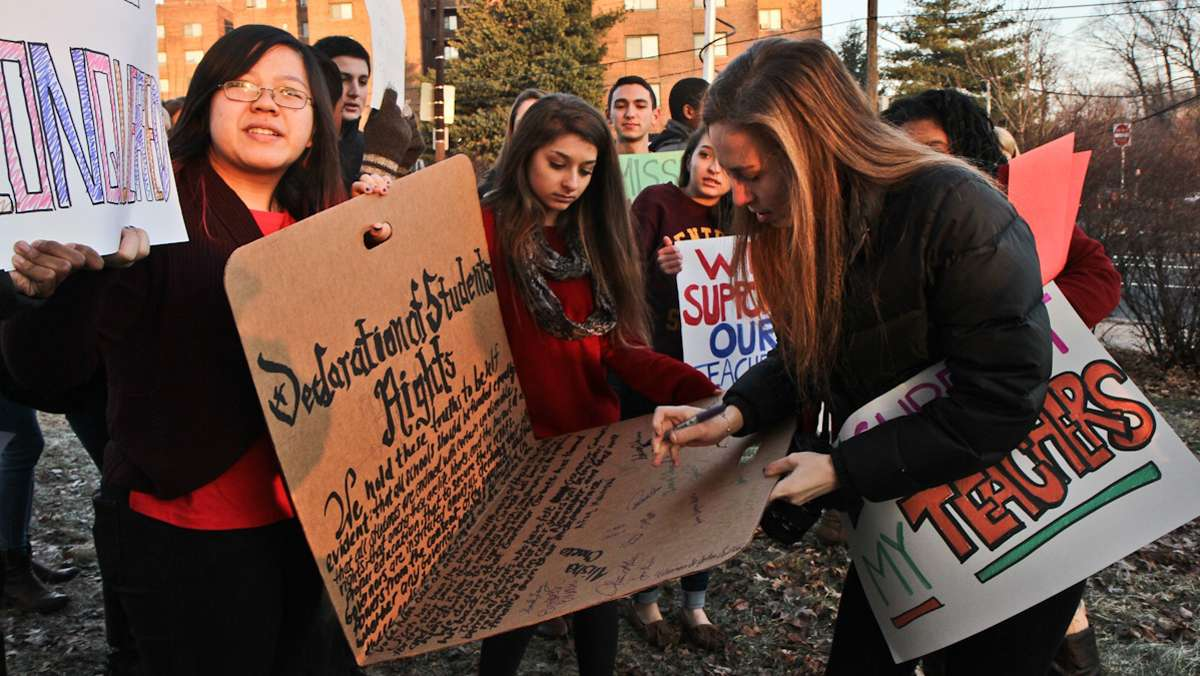 Central senior Dalya Hahan signs a Declaration of Student rights at a rally held outside the school prior to a visit from Pa Governor Corbett. (Kimberly Paynter/WHYY)