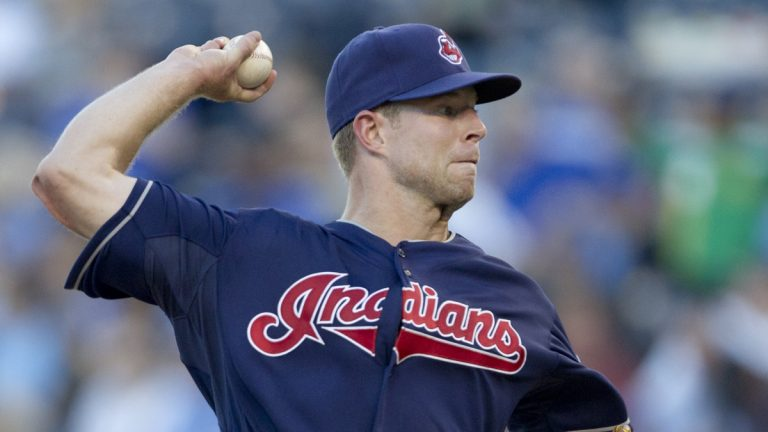 Cleveland Indians starting pitcher Corey Kluber throws to a Kansas City Royals batter during the first inning of a baseball game at Kauffman Stadium in Kansas City, Mo., Thursday, Aug. 2, 2012. (AP Photo/Orlin Wagner)