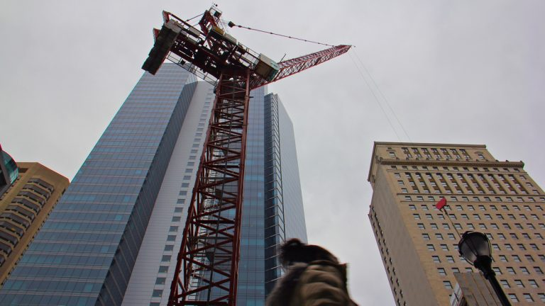 A large crane looms over the 1400 block of Chestnut Avenue.