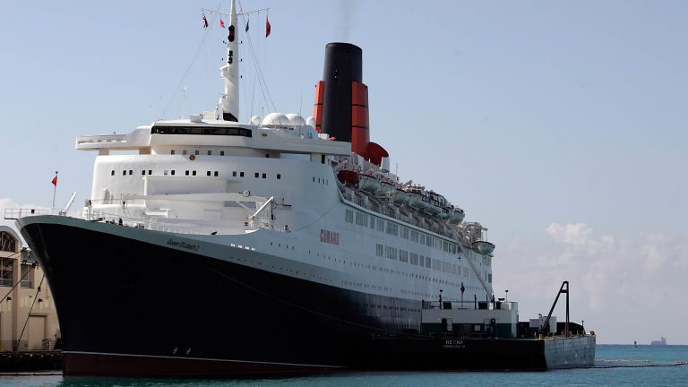 The Queen Elizabeth 2 docked at Honolulu Harbor in 2007. Federal public health officials boarded the ship to examine a stomach flu outbreak on the ship. The Centers for Disease Control and Prevention reported 276 passengers and 28 crew members had come down with norovirus. (AP Photo/Marco Garcia)