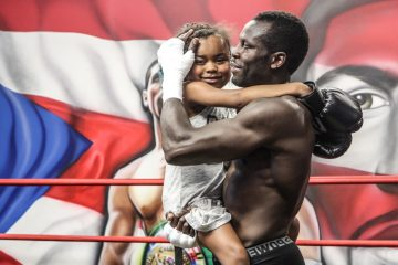 Philly boxer Steve Cunningham and his daughter Kennedy, 9, who received a heart transplant last December. (Kimberly Paynter/WHYY)